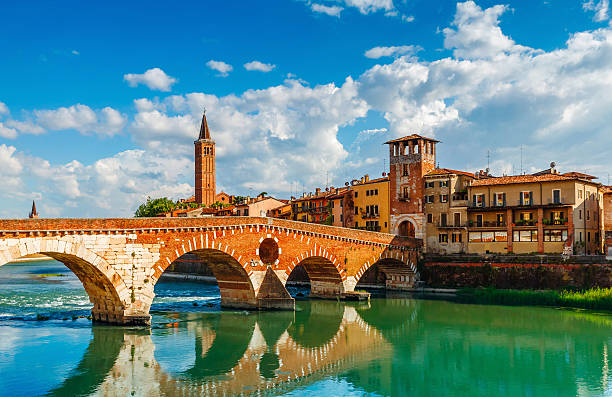 bridge ponte pietra in verona on adige river - venezien stock-fotos und bilder