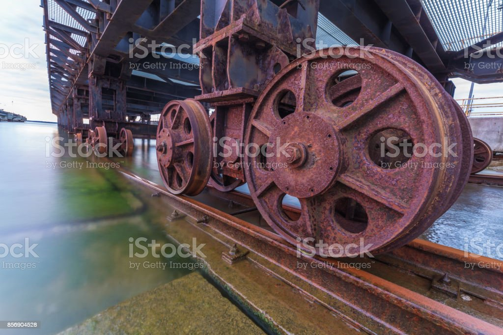 Bridge railroads leading into water stock photo