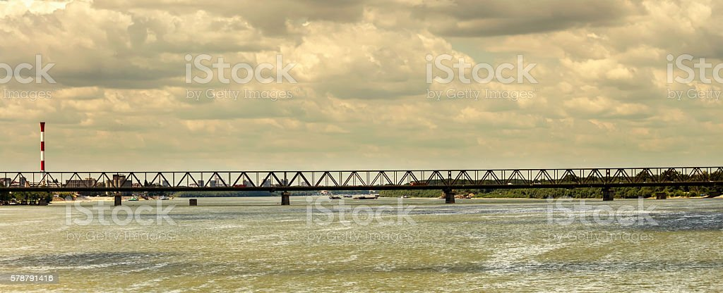 Bridge, river and stormy weather stock photo
