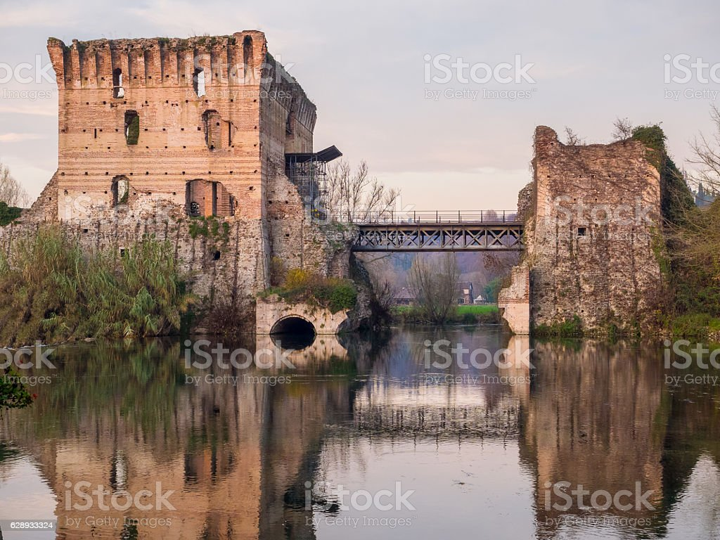Bridge ruins reflections at Borghetto Valeggio sul Mincio near M stock photo