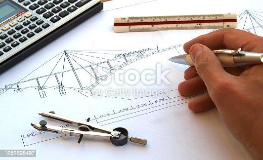 engineer working on a bridge sketch