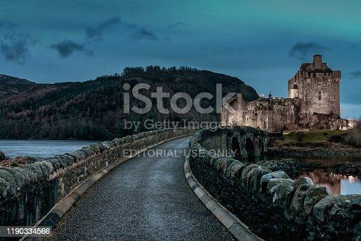 Dornie,Scotland,United Kingdom - November 12th, 2018: Stone Bridge towards the famous illuminated Eilean Donan Castle - the well known 'Highlander Castle' . The Eilean Donan Castle is build on a small islet in Loch Alsh in the Highland Region of Scotland at Twilight. Scotland, United Kingdom, Europe