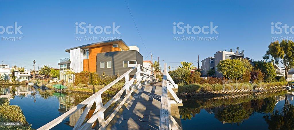 Bridge to luxury waterside homes royalty-free stock photo