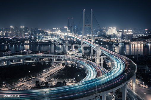 544101220 istock photo Bridge traffic at night in ShangHai China 953844924