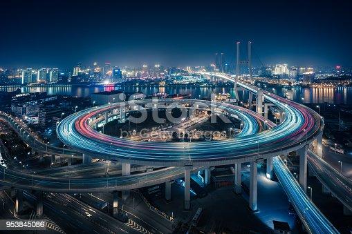 544101220 istock photo Bridge traffic at night in ShangHai China 953845086