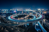 istock Bridge traffic at night in ShangHai China 953845086