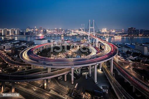 544101220 istock photo Bridge traffic at night in ShangHai China 953852276