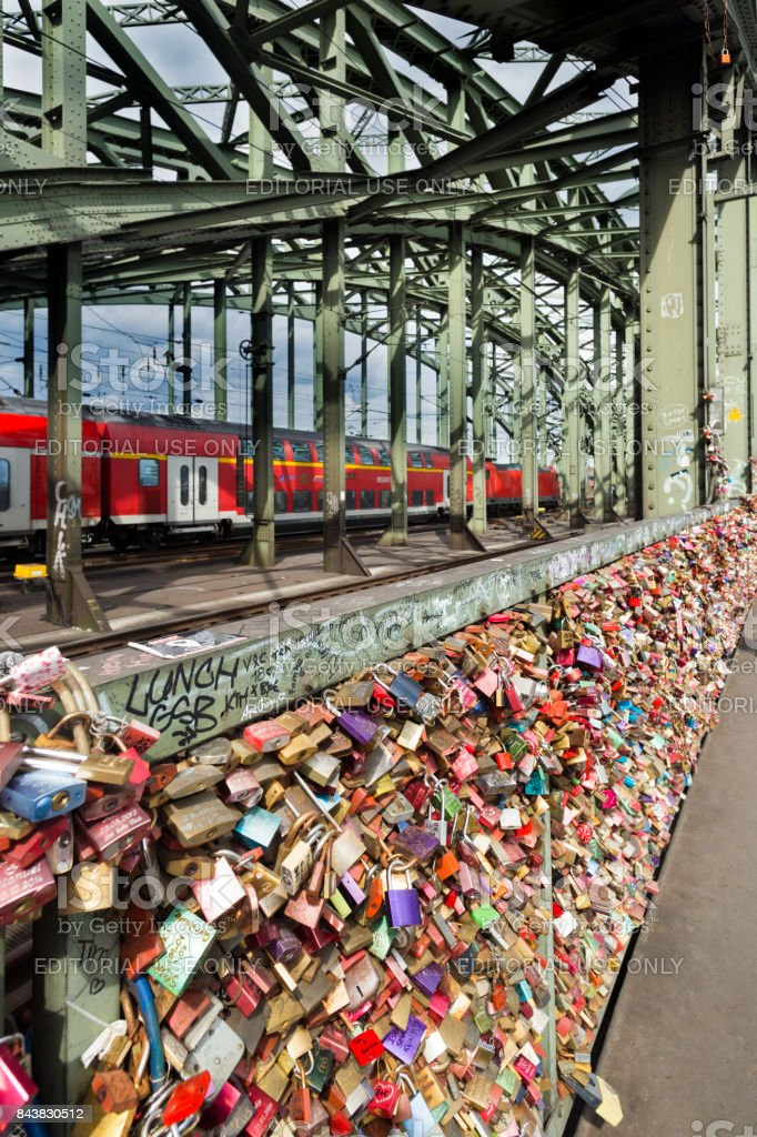 Bridge with a lot of locks and train on background stock photo