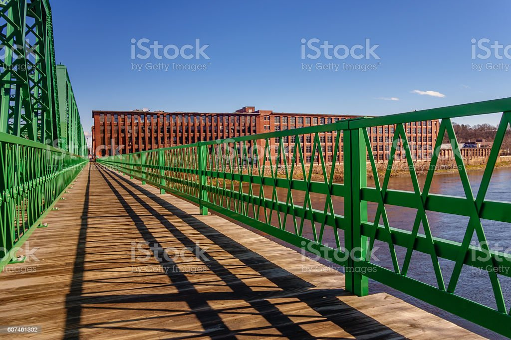 bridge with mill building stock photo