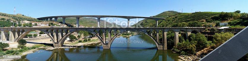 Bridges across Douro River east of Porto in the Portuguese wine region, terraced vineyards on hillslopes in the background, Peso da Regua, Portugal