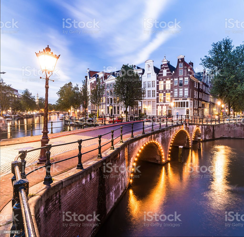 Bridges and Canals of Amsterdam Illuminated at Sunset Holland foto