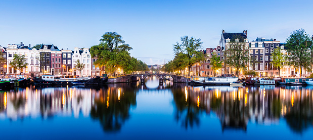 Bridge and canal houses in Amsterdam at twilight, Holland.