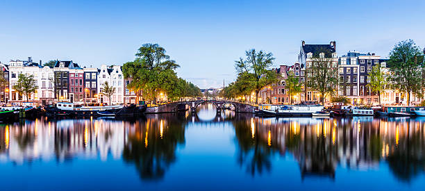 Bridges and Canals of Amsterdam Illuminated at Sunset Holland stock photo