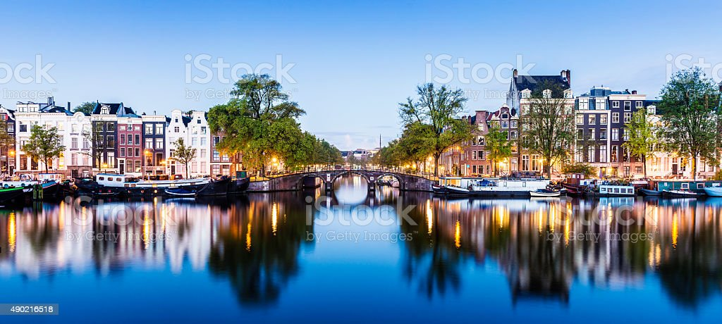 Bridges and Canals of Amsterdam Illuminated at Sunset Holland​​​ foto