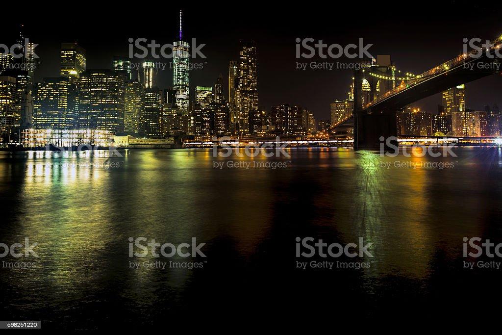 Bridges and Manhattan at night, New York City, USA. stock photo
