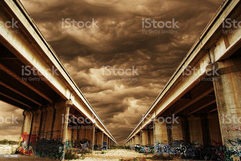 Bridges Covered in Graffiti with Dark Sky royalty-free stock photo