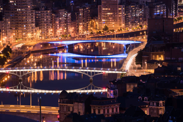 Bridges of Liege Belgium with light show over river Maas Bridges of Liege Belgium with light show over river Maas lulik stock pictures, royalty-free photos & images