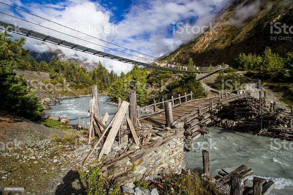 Bridges over the Marshyangdi River in Nepal stock photo