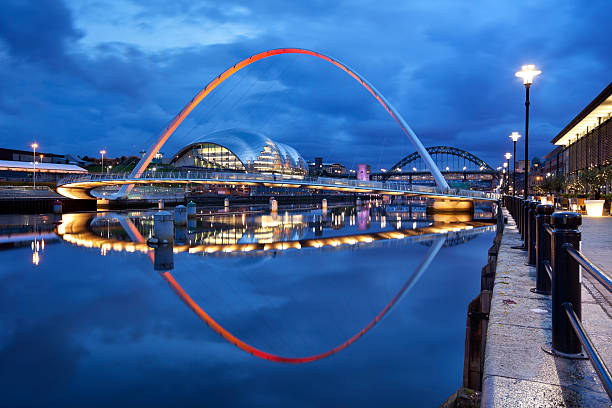bridges over the river tyne in newcastle, england at night - gateshead stock photos and pictures
