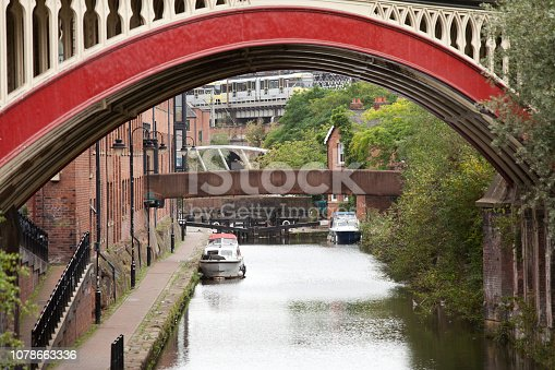 A train in the background leaving Bridgewater Canal, Manchester.