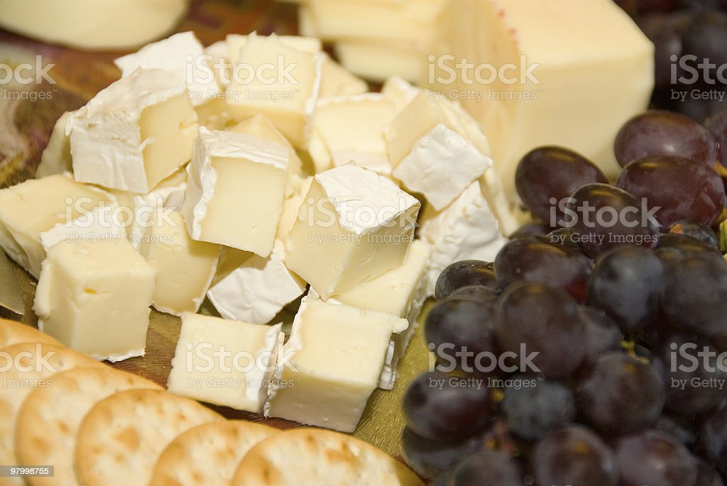 Brie cheese with grapes and crackers royalty-free stock photo