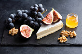 istock Brie or camembert cheese plate 1181549337
