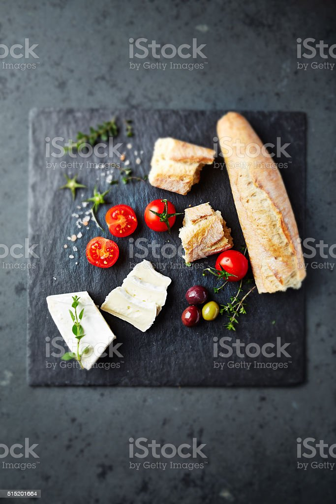 Brie with baguette and cherry tomatoes stock photo