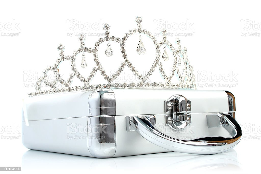 Briefcase and diadem royalty-free stock photo