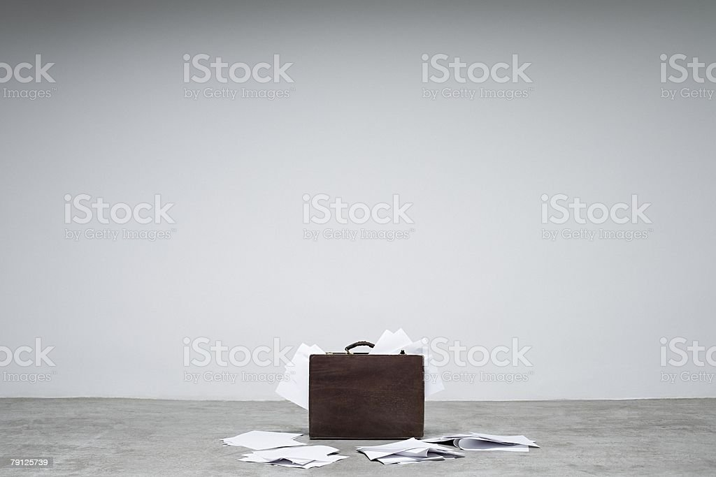 A briefcase and papers 免版稅 stock photo