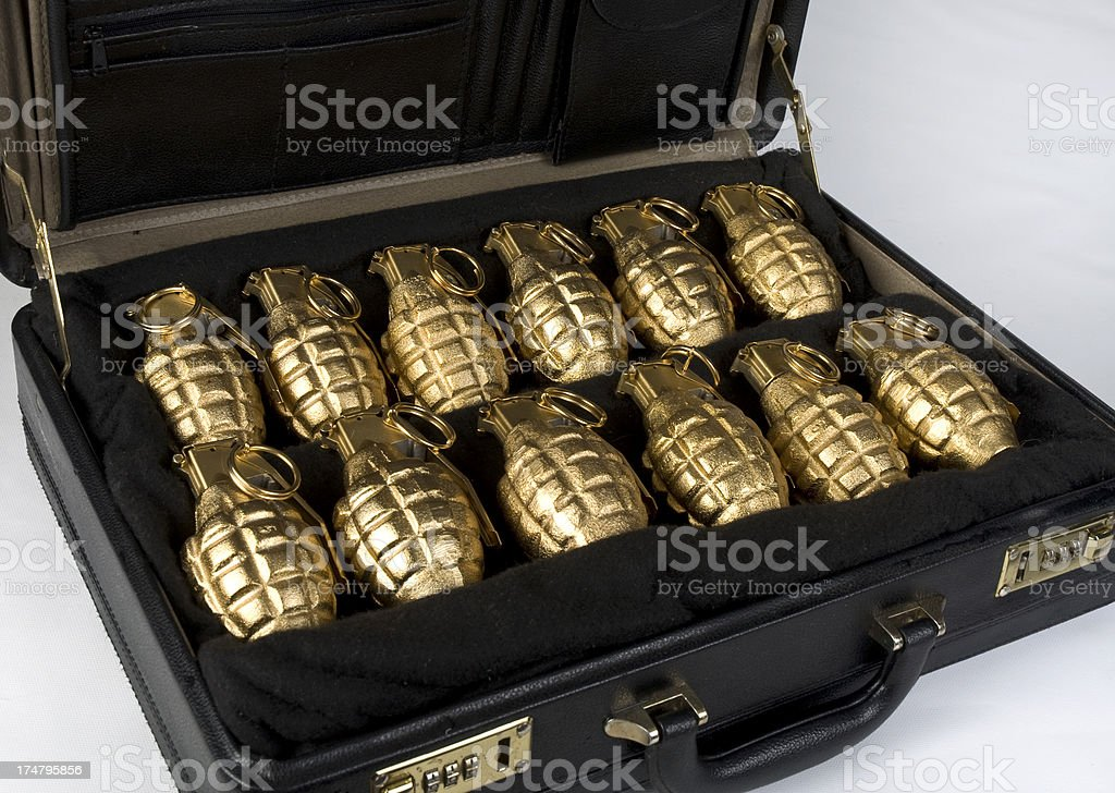 Briefcase Full Of Golden Hand Grenades royalty-free stock photo