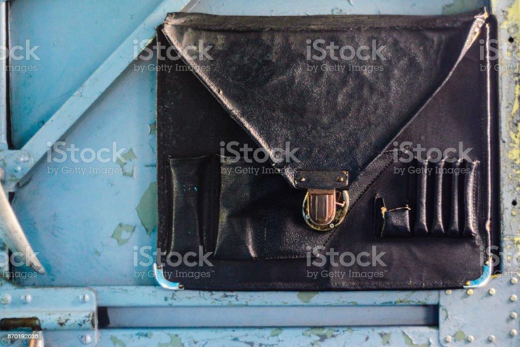 Briefcase on the cockpit door stock photo