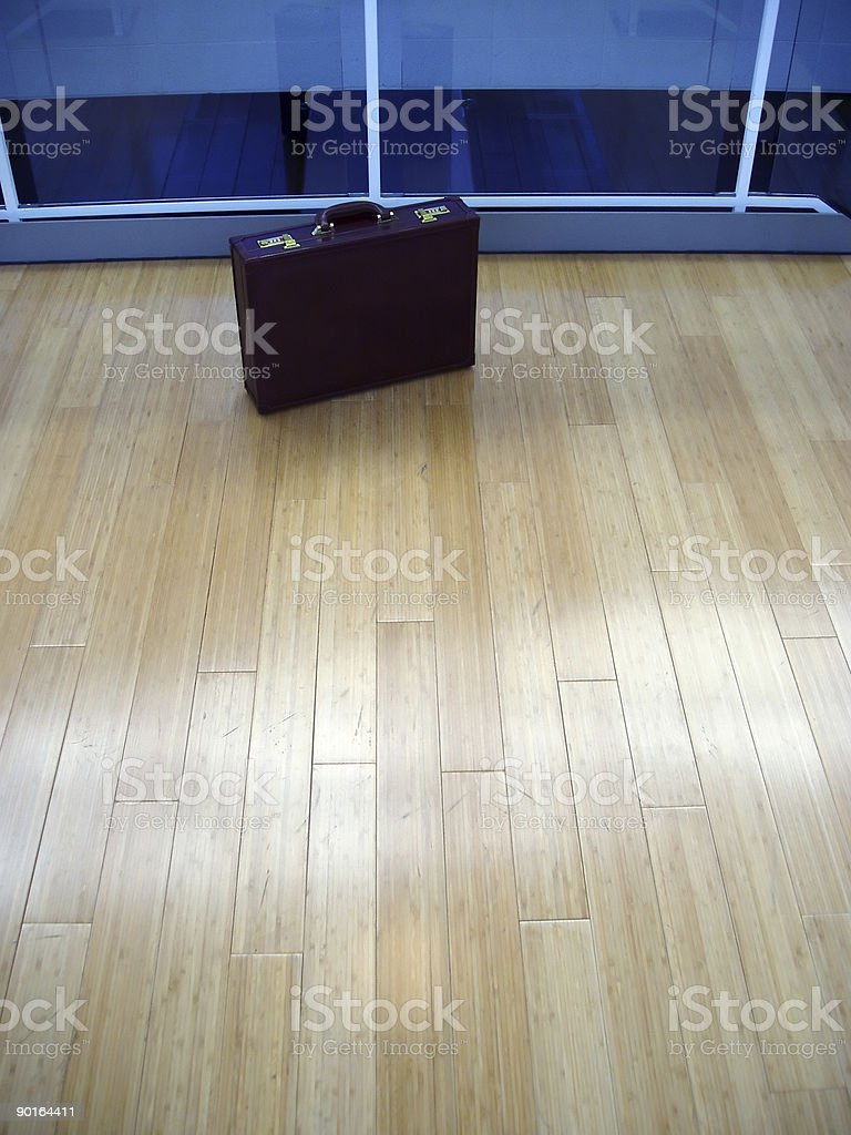 Briefcase on wood floor royalty-free stock photo