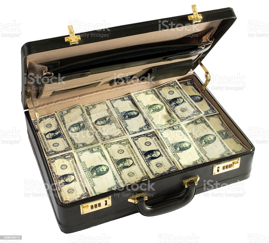 Briefcase packed full of dollar bills stock photo