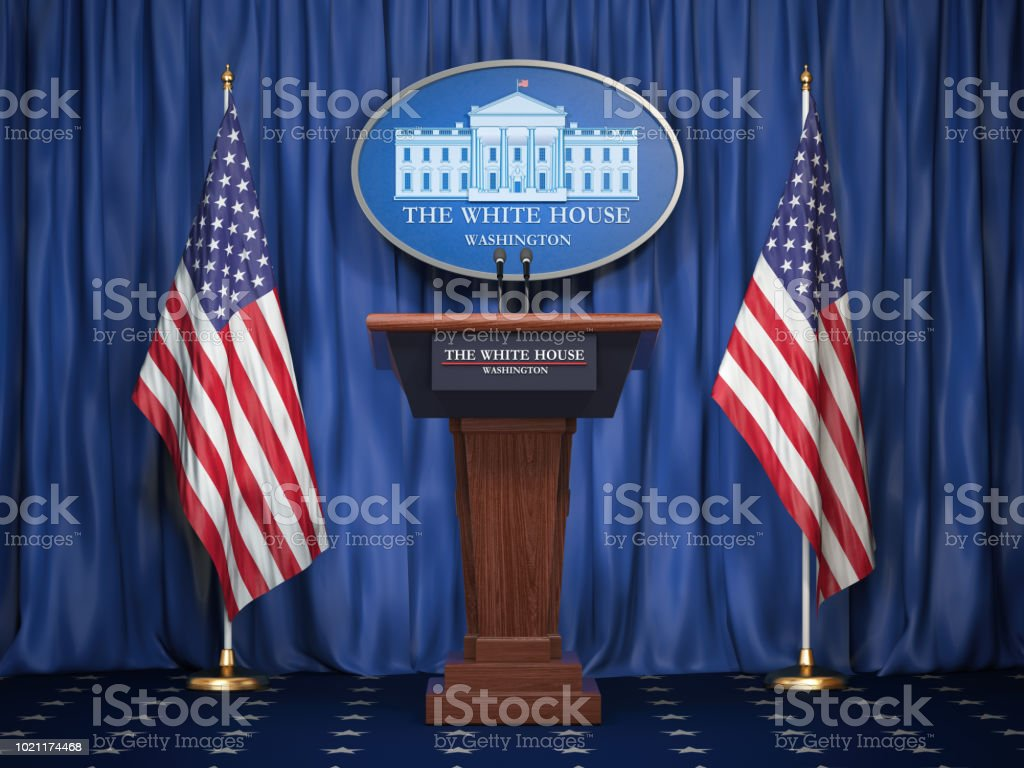 Briefing of president of US United States in White House. Podium speaker tribune with USA flags and sign of White Houise. Politics concept. stock photo