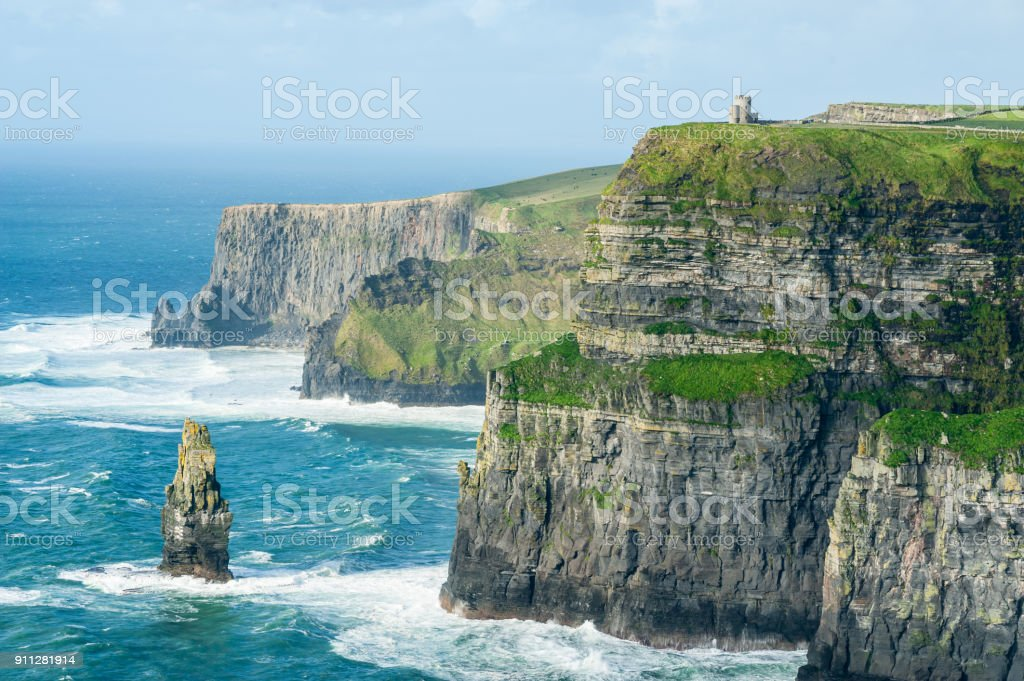 O'Brien's Tower on The Cliffs of Moher, Irelands Most Visited Natural Tourist Attraction, are sea cliffs located at the southwestern edge of the Burren region in County Clare, Ireland. stock photo