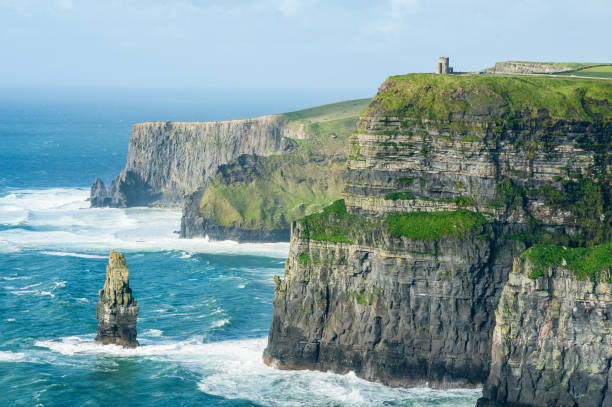 o'brien's tower on the cliffs of moher, irelands most visited natural tourist attraction, are sea cliffs located at the southwestern edge of the burren region in county clare, ireland. - cliffs of moher stock pictures, royalty-free photos & images