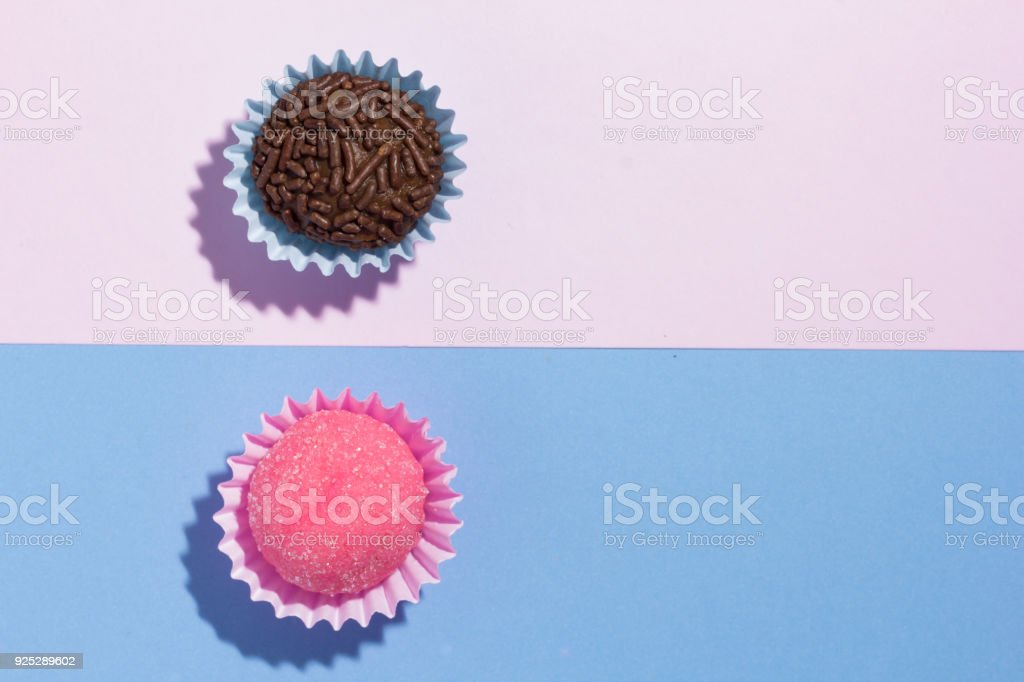 Brigadeiro and Bicho de Pe: sweets from Brazil. Child birthday party. Flat design of candy ball on color background. stock photo