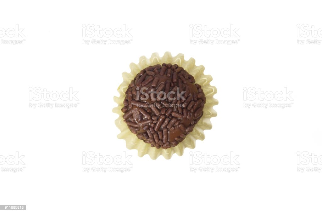 Brigadeiro is a chocolate truffle from Brazil. Cocoa and sprinkles of chocolate. Children birthday party sweet. Top view of isolated candy ball. stock photo