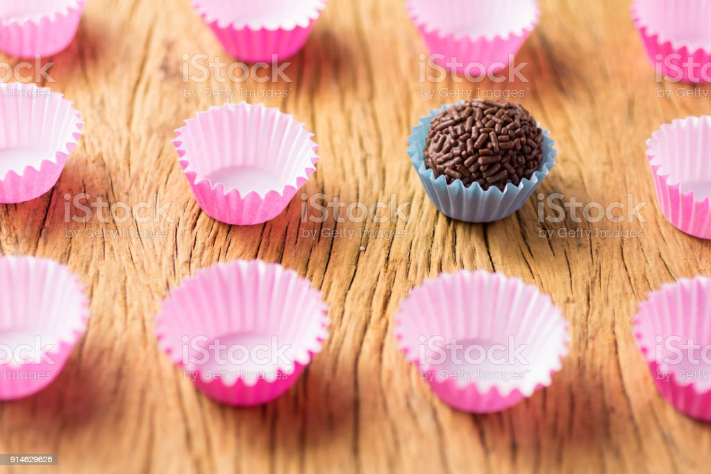 Brigadeiro is a chocolate truffle from Brazil. Cocoa and sprinkles of chocolate. Children birthday party sweet. stock photo