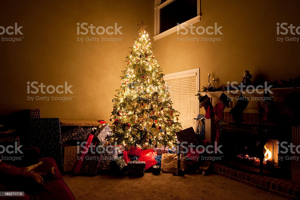 Brighly Lit Christmas Tree with Presents stock photo