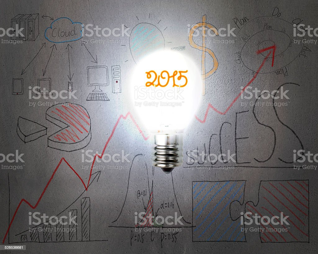 bright 2015 light bulb illuminated dark doodles wall stock photo