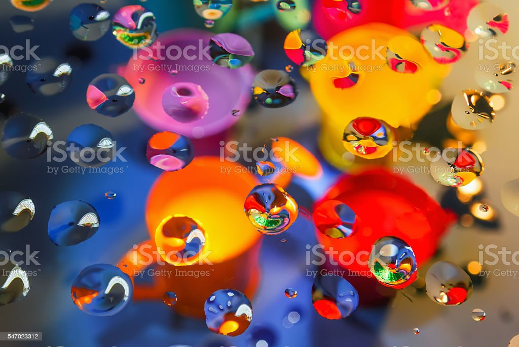 Bright abstract background through drops stock photo