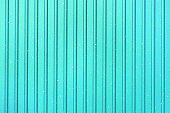 Bright abstract blue striped background. Texture of grill pan.