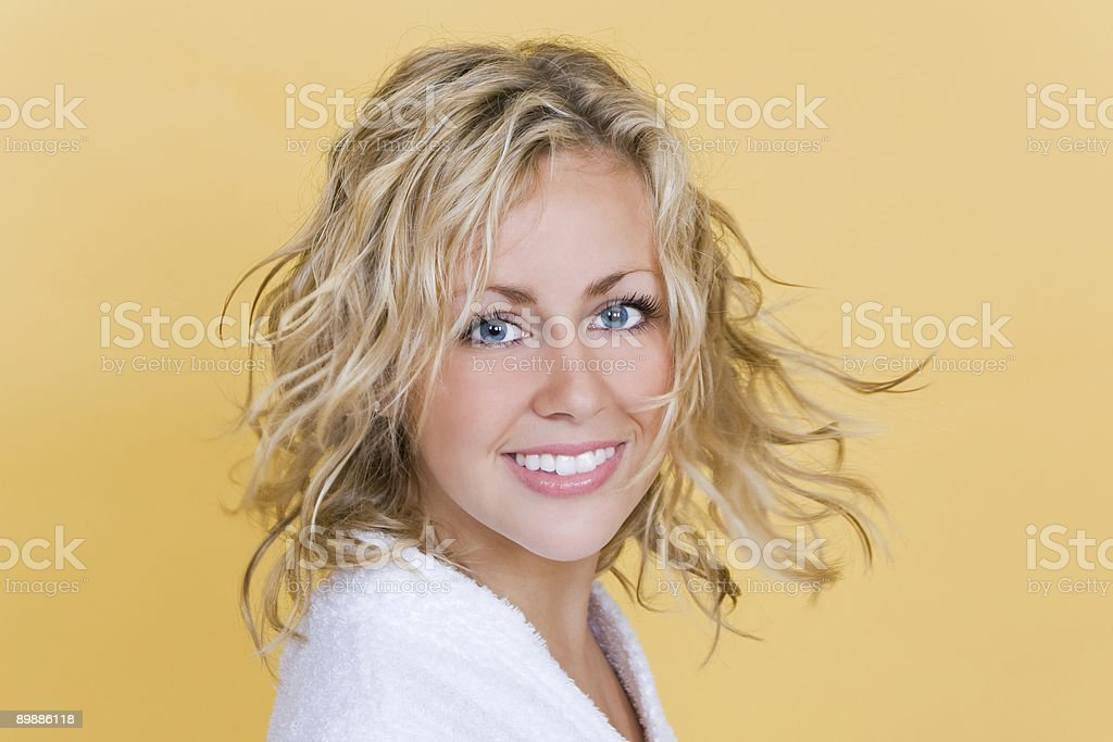 Bright and Beautiful Young Blond Woman Smiling In Bath Robe royalty free stockfoto