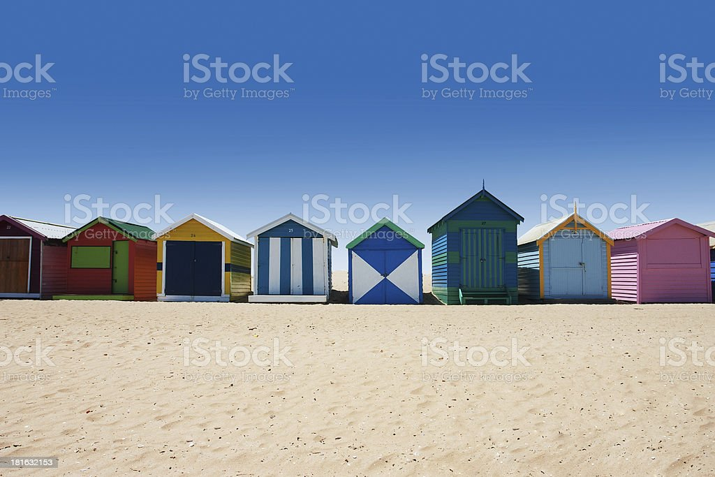 Bright and colorful houses on white sand beach royalty-free stock photo