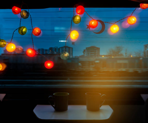 Bright and colorful lights in front of the train's window at dark night stock photo
