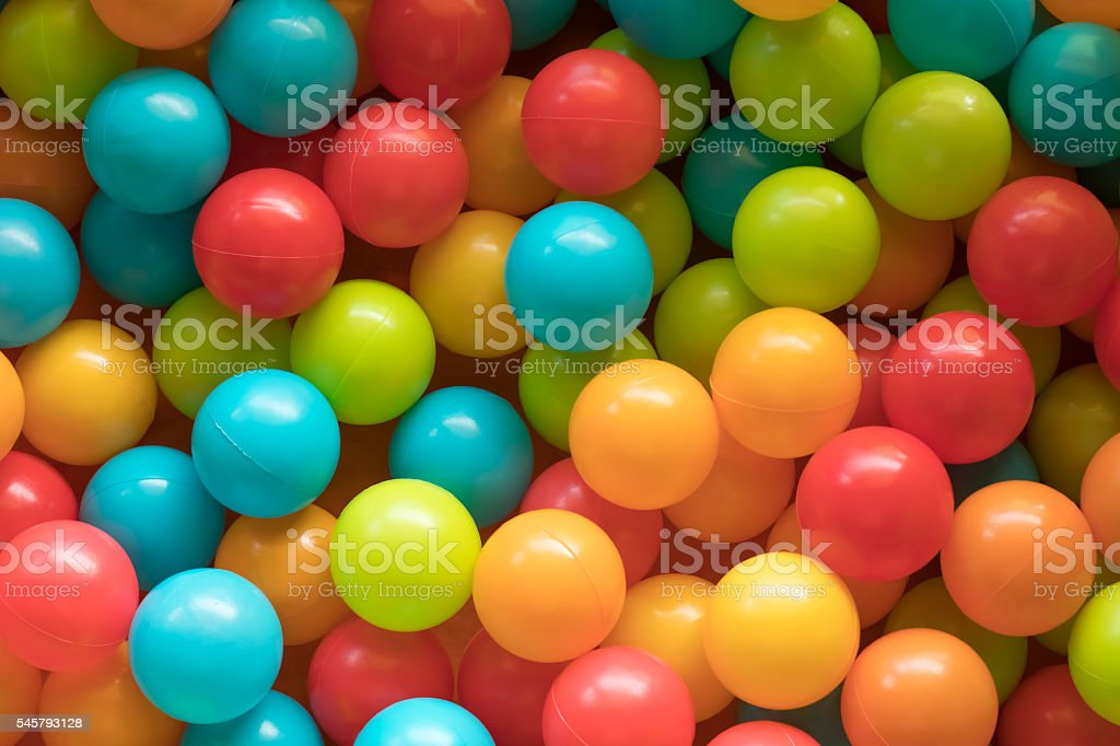 Bright and Colorful toy balls, kids ball pit background, softpla stock photo
