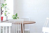 istock Bright and cozy room with a table, chairs and indoor plants. 1165360883