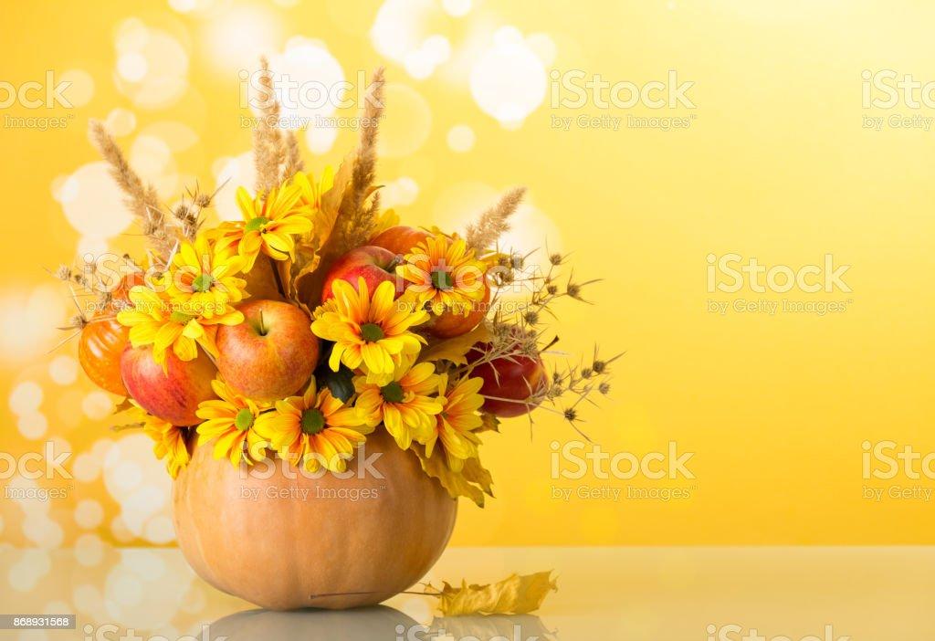 Bright autumn composition in pumpkin, on yellow stock photo