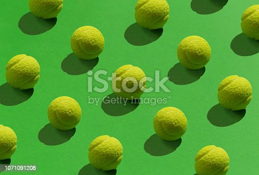 Candy that looks like tennis ball, texture on green background.